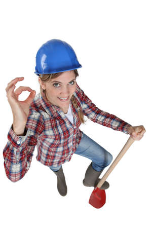 Tradeswoman giving the a-ok sign Stock Photo - 12761783