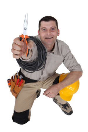 complicated: Electrician with pliers Stock Photo