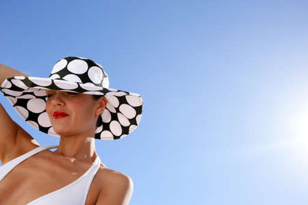 Chic woman in bikini and spotty hat photo