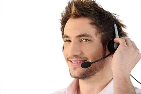 experienced operator: Man wearing telephone head-set
