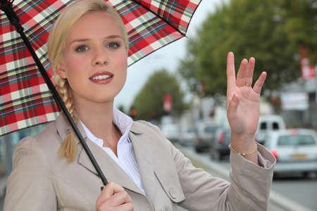 hailing: Woman hailing a taxi