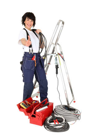 Thumbs up from a female electrician photo