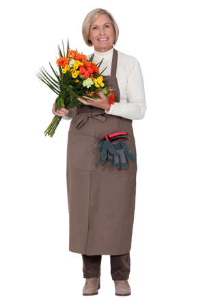 a florist with a flowers bouquet photo