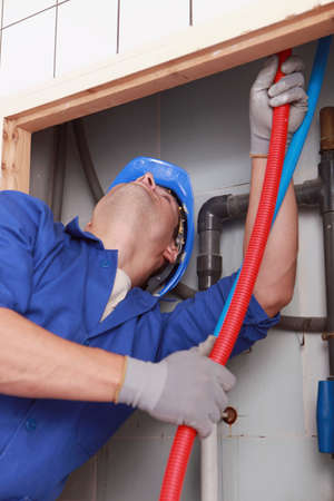 Skilled technician repairing canalizations photo