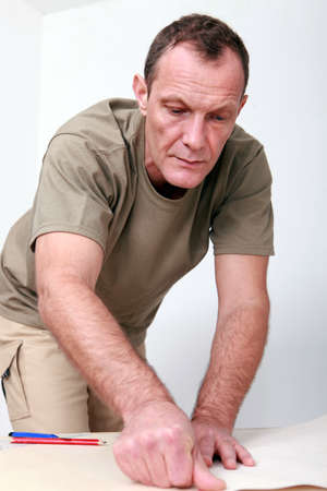 khaki pants: Man preparing wallpaper Stock Photo