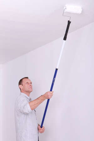 redecorating: Painter redecorating room Stock Photo