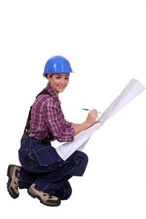 amend: Skilled construction worker amending a blueprint