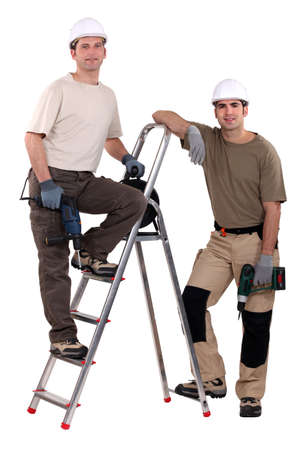 fixate: two workers posing with drills