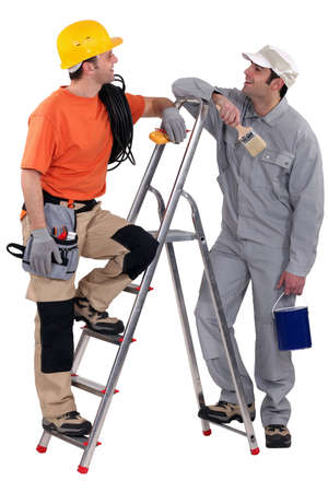 jobbing: Electrician stood with painter Stock Photo