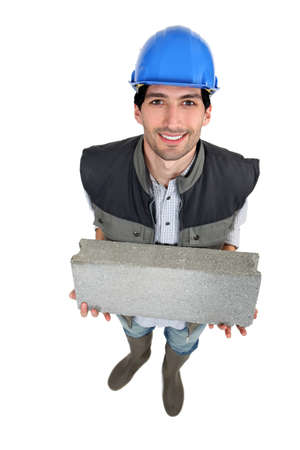 Builder with a block in his hands photo