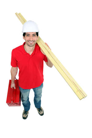 Builder with timber and a toolbox photo