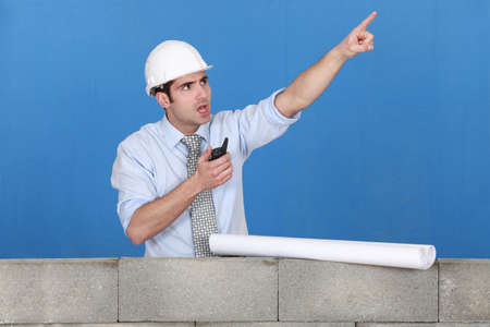 Foreman with a walkytalky Stock Photo - 12597924
