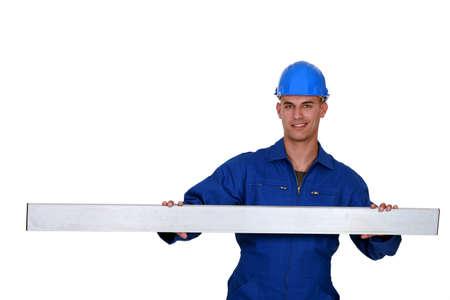 firmeza: Trabajador de la construcción quedó con el metal de frijol Foto de archivo