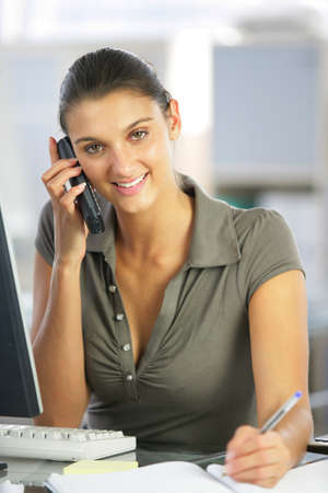 businesswoman talking on the phone and taking notes Stock Photo - 12760773