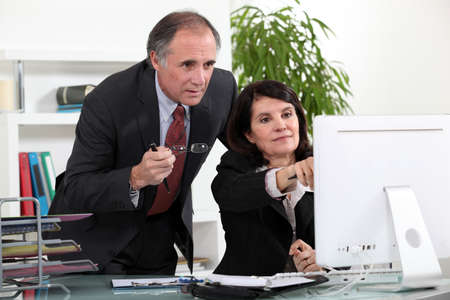 55 60 years: Colleagues discussing a project Stock Photo