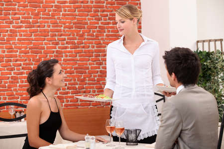 Young couple in classy restaurant photo
