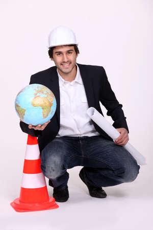 Architect holding a globe photo