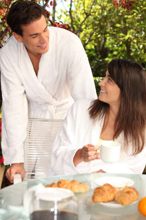 couple dressed in bathrobe at breakfast photo