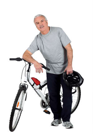 bicycle walk: a mature man and a mountain bike Stock Photo