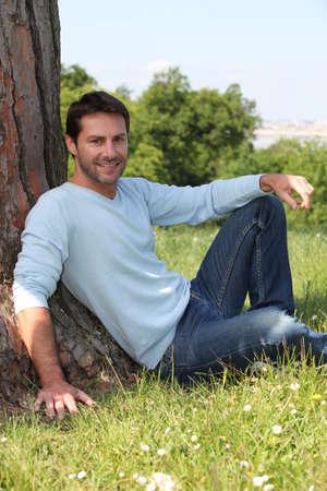 men 45 years: Man sitting under a tree