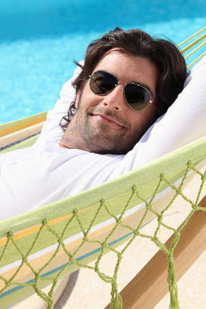 stubble: Man relaxing by the pool