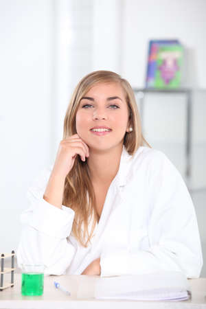 Chemistry student in the classroom Stock Photo - 12760905