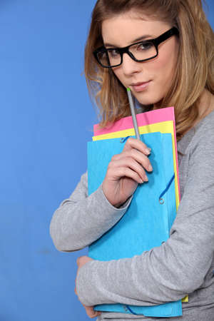 Teenage girl with folders photo