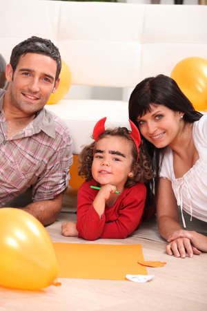 antichrist: Young family at Halloween Stock Photo