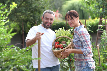 allotment: Couple stood in garden with vegetables