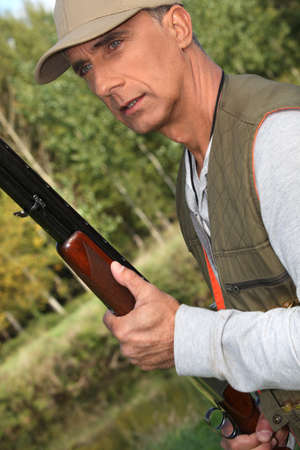 Hunter with a shotgun photo