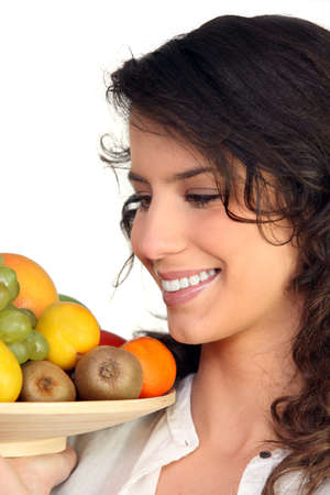 Woman carrying fruit Stock Photo - 12762599