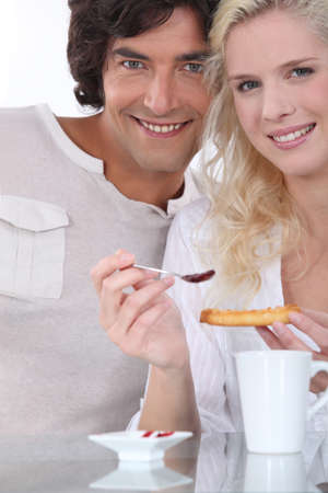 Couple having breakfast photo