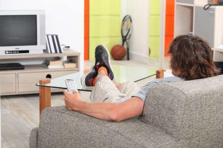 perezoso: Lazy adultos j�venes en el hogar Foto de archivo