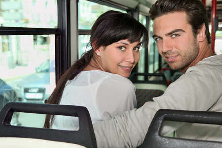 25 to 30: Couple riding the bus together