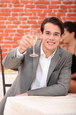 Man raising a glass of champagne Stock Photo - 12763338
