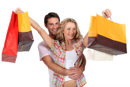 stretched out: Couple with shopping bags Stock Photo