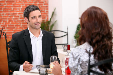 wooing: Couple eating out in a restaurant Stock Photo