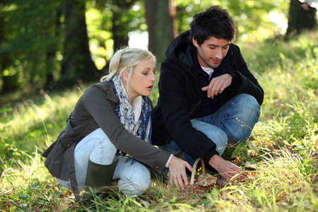 blonde haired: portrait of a couple in woods Stock Photo