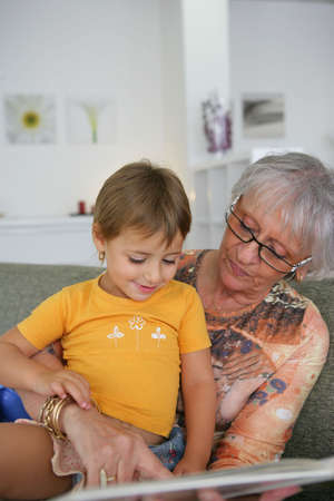 Young child reading with grandma Stock Photo - 12906353