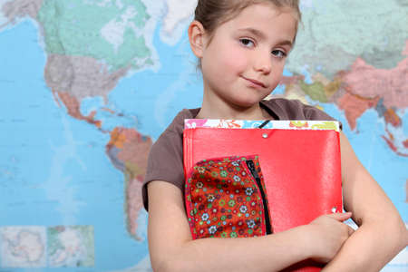 keen: Young girl in geography class Stock Photo