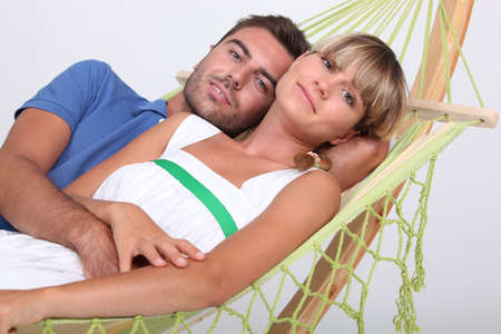 portrait of a couple in a hammock Stock Photo - 12597832