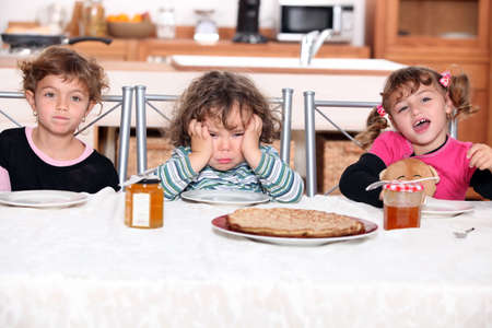 choleric: three children eating crepes