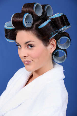 woman in bath robe and curlers in her hair photo