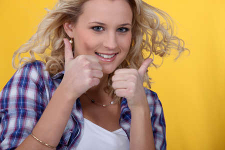 bonny: Blond woman giving thumbs-up Stock Photo