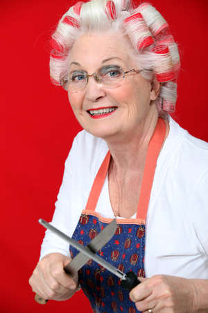 sharpening: Old lady with hair rollers Stock Photo