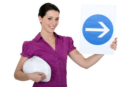 obligation: Woman holding sign of obligation to turn right