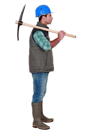 pickaxe: Construction working holding a pickaxe