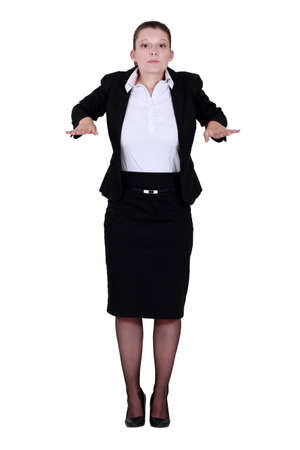 calm down: Businesswoman with palms out flat Stock Photo