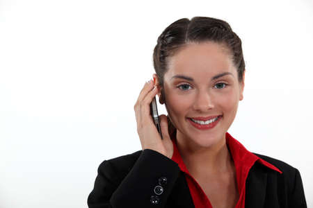 businesswoman talking on her cell Stock Photo - 12906196