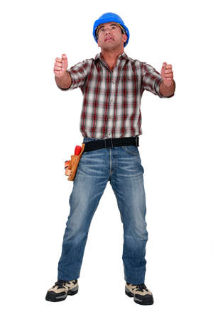Laborer gripping an imaginary ladder Stock Photo - 12760813